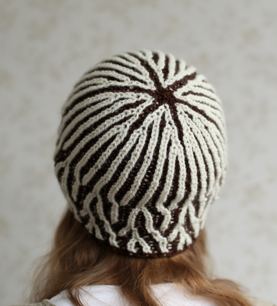 Brown and white Moreeni hat