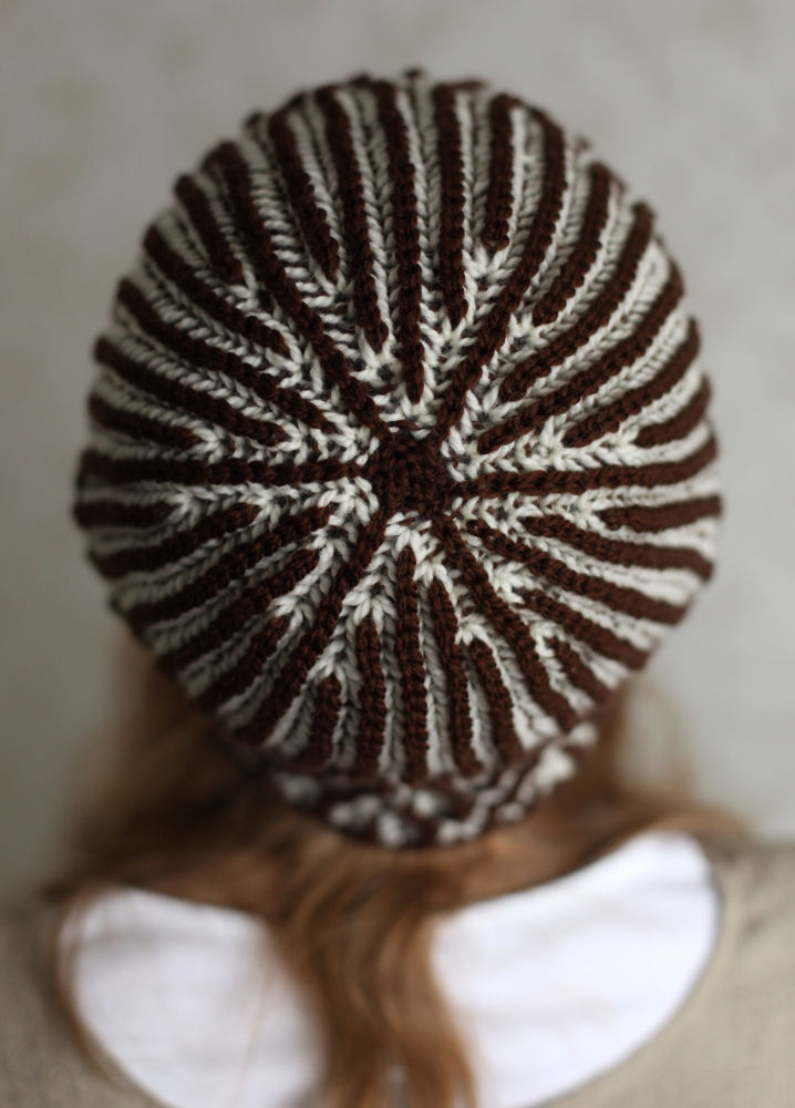 Brown and white Moreeni hat inside out